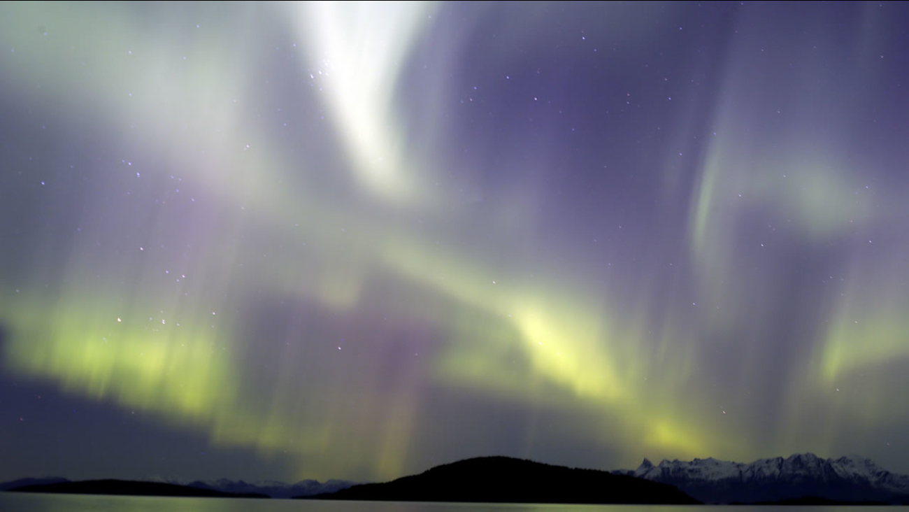 The aurora borealis, or Northern Lights, are seen over the Norwegian town of Harstad, Wednesday, Oct. 7, 2015.