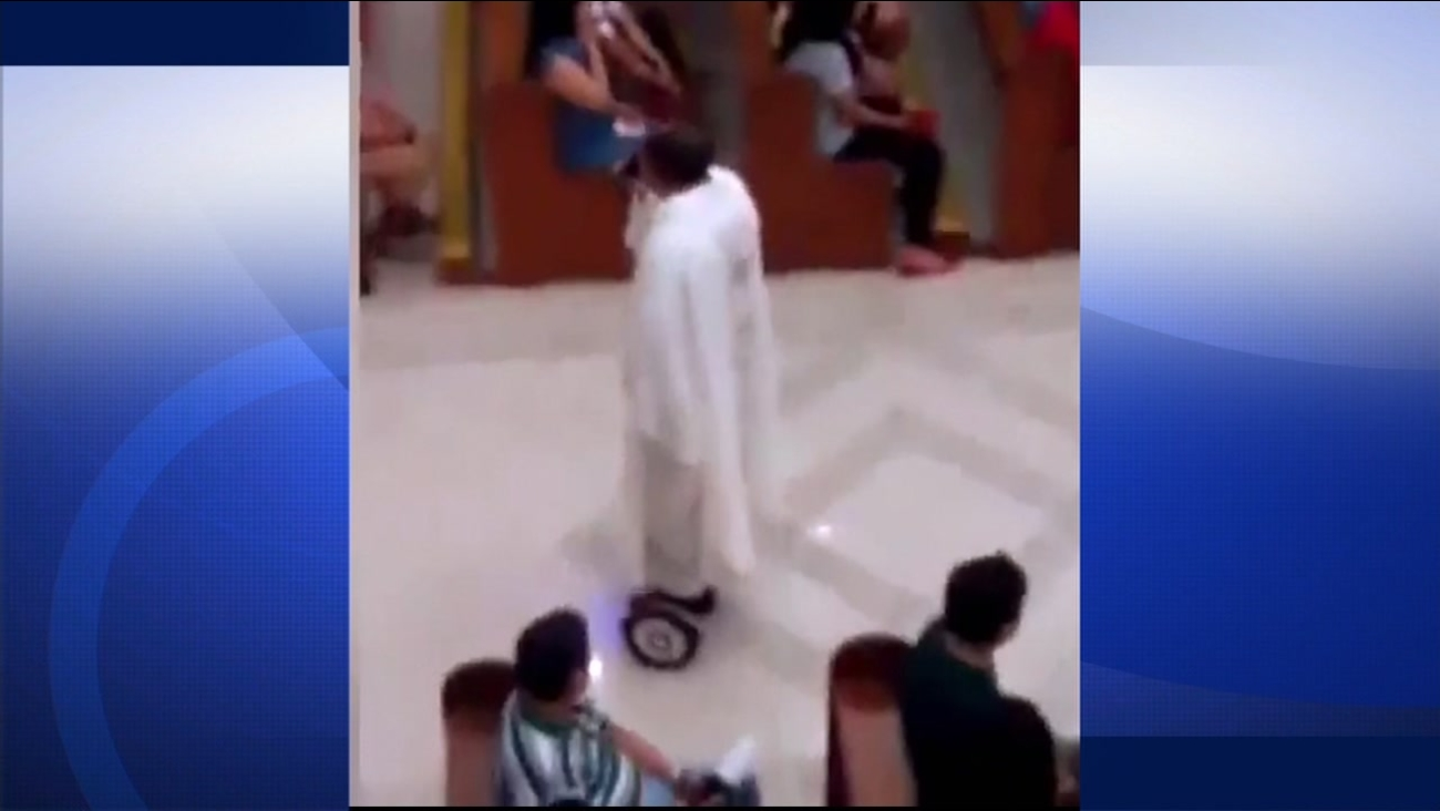 Video shows a priest in the Philippines riding his hoverboard during mass.