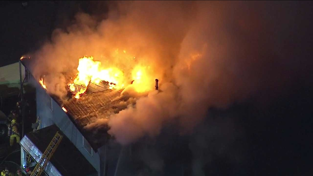 Firefighters with the Los Angeles Fire Department battle a blaze at a two-story residence in the 100 block of S. Avenue 54 in Highland Park on Wednesday, Dec. 30, 2015.