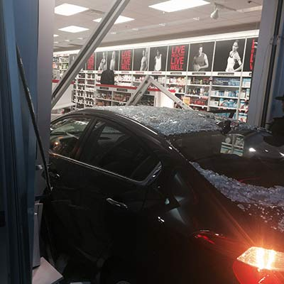 """<div class=""""meta image-caption""""><div class=""""origin-logo origin-image wls""""><span>WLS</span></div><span class=""""caption-text"""">A driver lost control of his car and crashed into a GNC store at a Country Club Hills strip mall.</span></div>"""