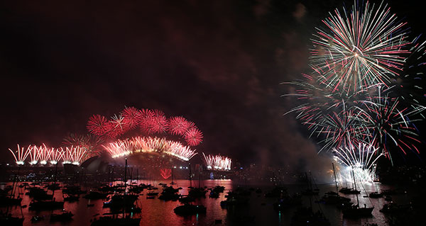 <div class='meta'><div class='origin-logo' data-origin='none'></div><span class='caption-text' data-credit='AP Photo/Rob Griffith'>Fireworks explode over the Opera House and Harbour Bridge during New Year's Eve fireworks display in Sydney, Australia, Friday, Jan. 1, 2016.</span></div>