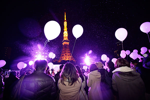 <div class='meta'><div class='origin-logo' data-origin='none'></div><span class='caption-text' data-credit='AP Photo/Eugene Hoshiko'>People wait to release balloons to celebrate the new year with Tokyo Tower in the background in Japan as 2016 approaches in the final hours of Thursday, Dec. 31, 2015.</span></div>