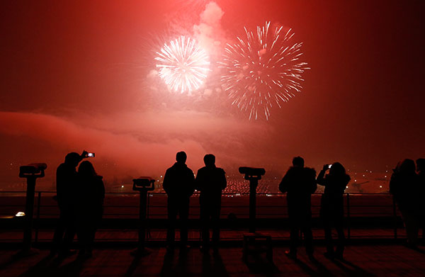 <div class='meta'><div class='origin-logo' data-origin='none'></div><span class='caption-text' data-credit='AP Photo/Lee Jin-man'>People watch the fireworks to celebrate the new year at the Imjingak Pavilion near the border village of Panmunjom in Paju, South Korea, Friday, Jan. 1, 2016.</span></div>