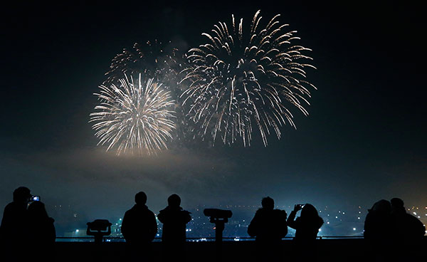 <div class='meta'><div class='origin-logo' data-origin='none'></div><span class='caption-text' data-credit='AP Photo/Lee Jin-man'>People watch and use their smartphones to take picture of fireworks, to celebrate the new year at the Imjingak Pavilion in South Korea on Jan. 1, 2016.</span></div>