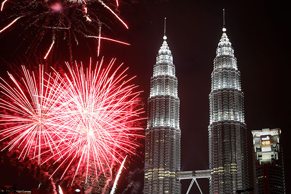<div class='meta'><div class='origin-logo' data-origin='none'></div><span class='caption-text' data-credit='AP Photo/Joshua Paul'>Fireworks explode in front of Malaysia's landmark building, Petronas Twin Towers, during the New Year's Eve celebration in Kuala Lumpur, Malaysia, Friday, Jan. 1, 2016.</span></div>