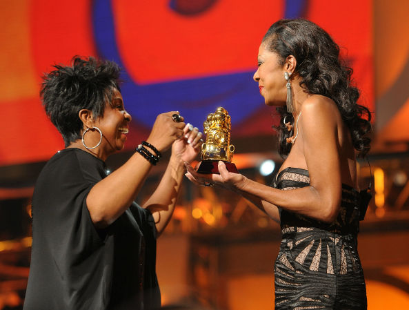 <div class='meta'><div class='origin-logo' data-origin='none'></div><span class='caption-text' data-credit=''>Singer Natalie Cole presents Gladys Knight with the Legend Award on Centric's 3rd Annual Soul Train Awards in 2011 in Atlanta. (AP photo/ Frank Micelotta)</span></div>