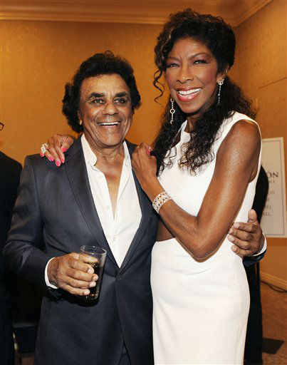 <div class='meta'><div class='origin-logo' data-origin='none'></div><span class='caption-text' data-credit=''>Singers Johnny Mathis, left, and Natalie Cole pose together at the 2014 Carousel of Hope Ball at the Beverly Hilton Hotel on Saturday, Oct. 11, 2014. (AP photo/Chris Pizzello)</span></div>