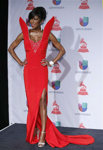 """<div class=""""meta image-caption""""><div class=""""origin-logo origin-image none""""><span>none</span></div><span class=""""caption-text"""">Natalie Cole arrives at the 14th Annual Latin Grammy Awards in Las Vegas in 2013. (Photo by Eric Jamison/Invision/AP) (Photo/Eric Jamison)</span></div>"""