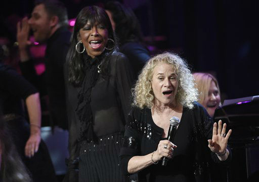 <div class='meta'><div class='origin-logo' data-origin='none'></div><span class='caption-text' data-credit=''>Singer Carole King, right, is joined by Natalie Cole at the SeriousFun Children's Network, May 14, 2015, in Los Angeles.  (AP Photo/Chris Pizzello)</span></div>