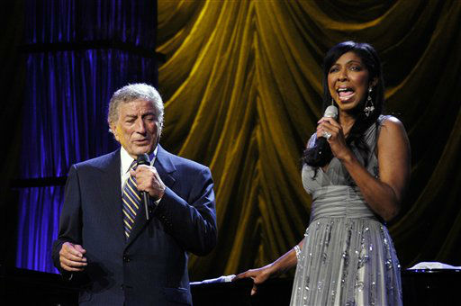 """<div class=""""meta image-caption""""><div class=""""origin-logo origin-image none""""><span>none</span></div><span class=""""caption-text"""">Tony Bennett sings a duet with Natalie Cole at the 106.7 Lite FM """"One Night With Lite"""" concert in New York in 2006. ( AP Photo/ Jim Cooper)</span></div>"""