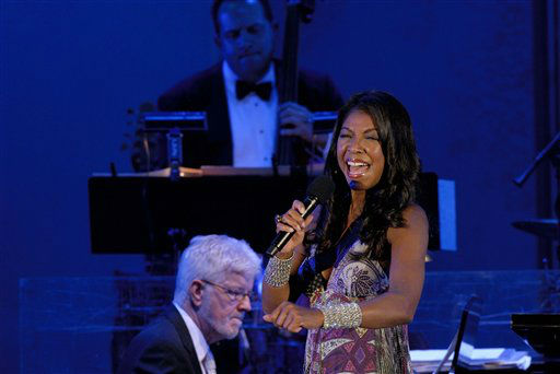 """<div class=""""meta image-caption""""><div class=""""origin-logo origin-image none""""><span>none</span></div><span class=""""caption-text"""">Natalie Cole belts out a song at the """"70th Birthday Celebration"""" held on behalf of Nancy Wilson at the Hollywood Bowl in 2007.  (AP Photo/Earl Gibson III ) (AP Photo/ EARL GIBSON III)</span></div>"""