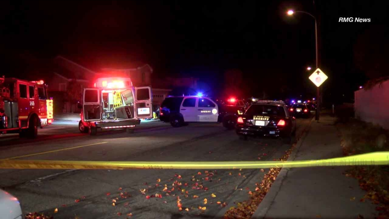 Police investigate the scene of a shooting that left four dead in Rowland Heights on New Year's Eve, Dec. 31, 2015.