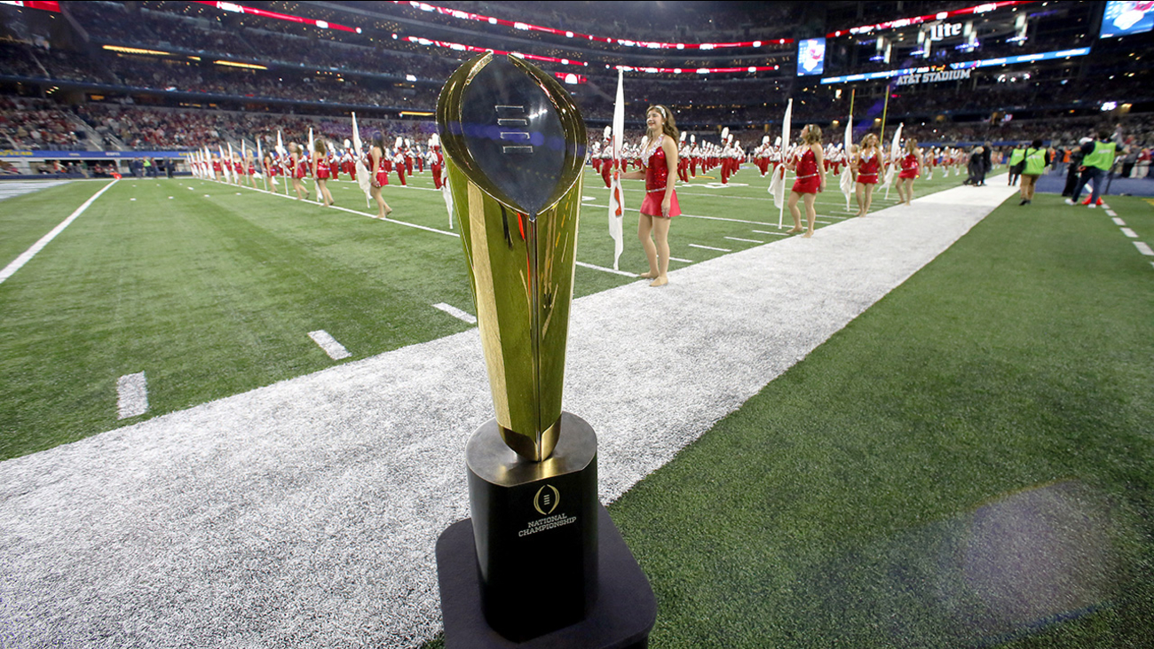 A College Football Playoff National Championship Trophy is seen on the field before the Cotton Bowl on Thursday night,