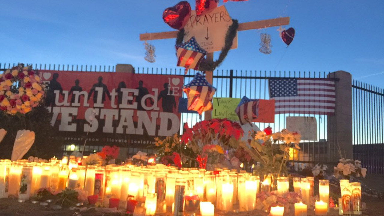 A memorial sits in front of the Inland Regional Center in San Bernardino where 14 people were killed in a terror attack on Dec. 2, 2015.