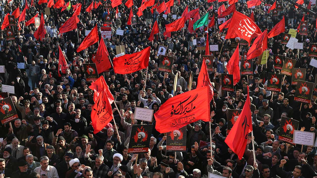 Iranian demonstrators chant slogans and hold anti-Saudi placards and flags during a rally to protest the execution by Saudi Arabia last week of Sheikh Nimr al-Nimr in Tehran, Iran, Monday, Jan. 4, 2016.