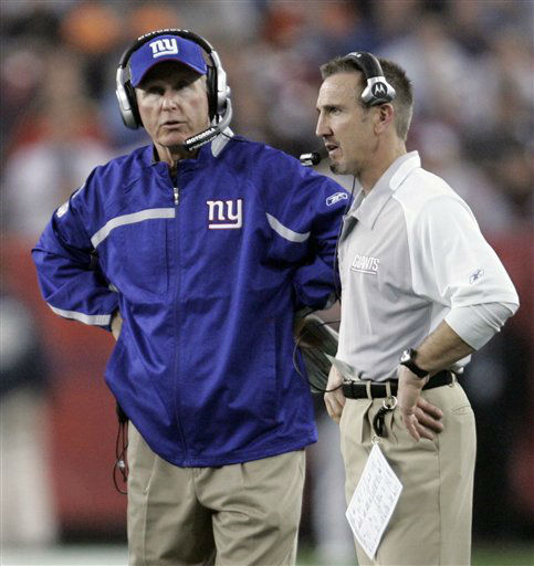 """<div class=""""meta image-caption""""><div class=""""origin-logo origin-image none""""><span>none</span></div><span class=""""caption-text"""">Giants head coach Tom Coughlin, left, and defensive coordinator Steve Spagnuolo talk on the sideline during Super Bowl XLII in 2008. (AP Photo/ Eric Gay)</span></div>"""