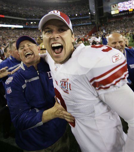 """<div class=""""meta image-caption""""><div class=""""origin-logo origin-image none""""><span>none</span></div><span class=""""caption-text"""">Giants kicker Lawrence Tynes (9) and Giants head coach Tom Coughlin celebrate after the Giants beat the New England Patriots 17-14 in the Super Bowl XLII. (AP Photo/ David J. Phillip)</span></div>"""