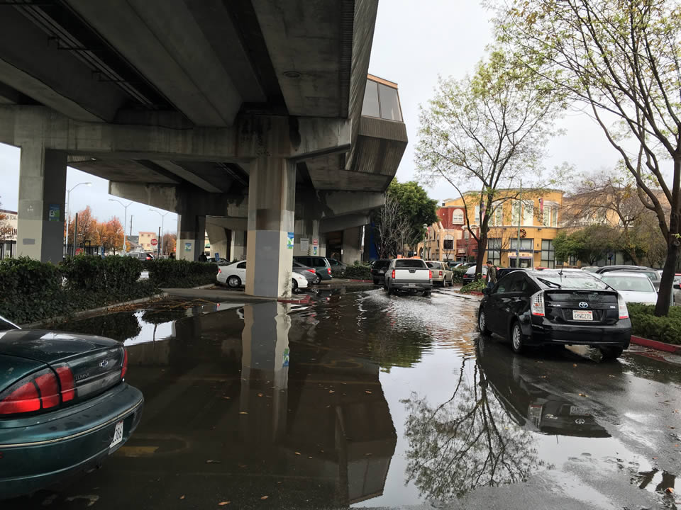 "<div class=""meta image-caption""><div class=""origin-logo origin-image none""><span>none</span></div><span class=""caption-text"">This photo shows flooding at a parking lot next to the Fruitvale BART station in Oakland, Calif. on Tuesday, January 5, 2016. (KGO-TV)</span></div>"