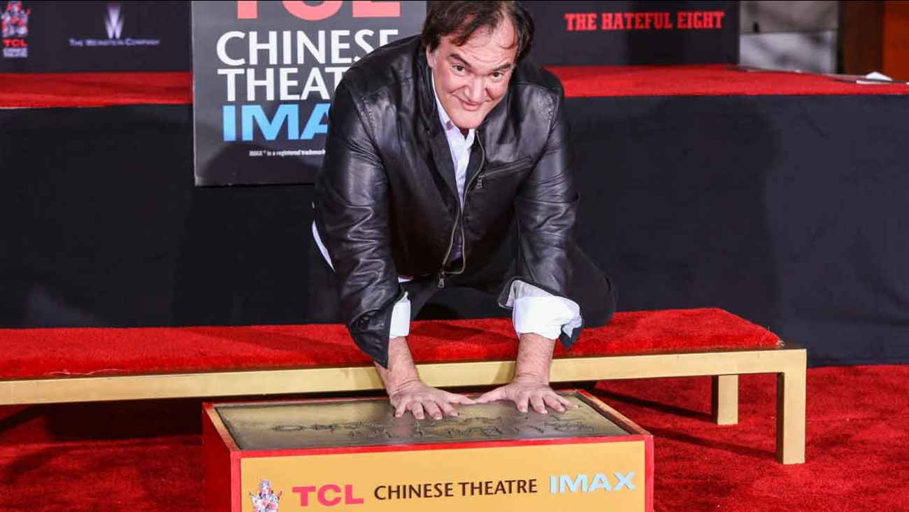 Quentin Tarantino poses in his handprints at a ceremony honoring him at the TCL Chinese Theatre on Tuesday, Jan. 5, 2016, in Los Angeles.