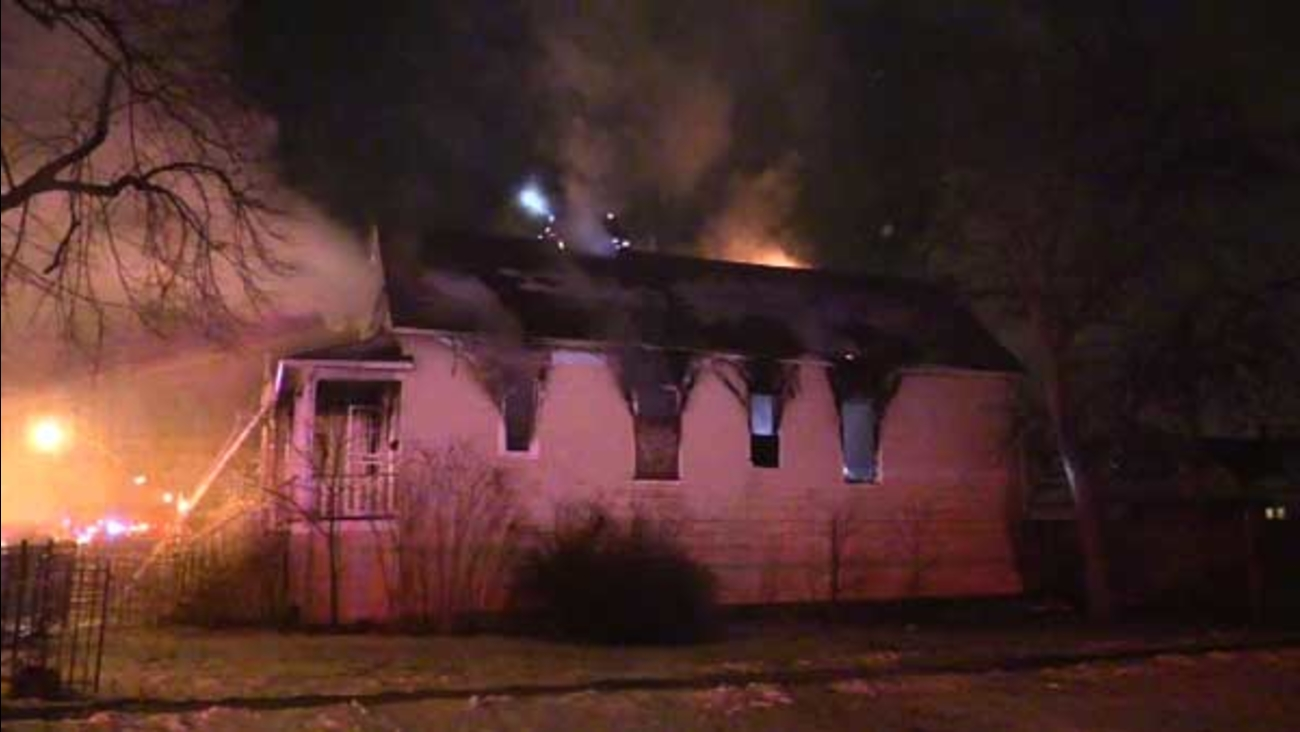 Four people were forced out of their homes after fire spread from an empty building to an apartment building in the city's South Chicago neighborhood.