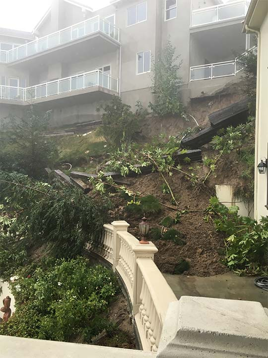 """<div class=""""meta image-caption""""><div class=""""origin-logo origin-image kabc""""><span>KABC</span></div><span class=""""caption-text"""">Rain-soaked earth gave way under a home in Pasadena, causing some retaining walls to tumble down a hillside on Wednesday, Jan. 6, 2016.</span></div>"""