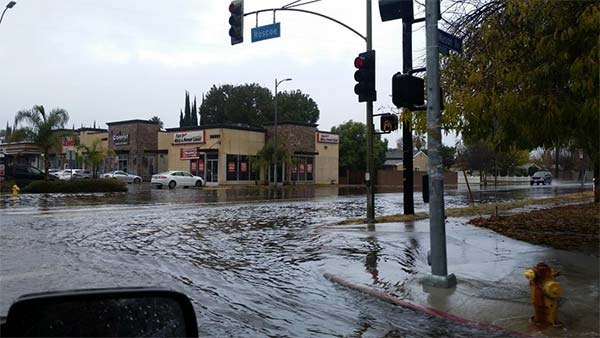 """<div class=""""meta image-caption""""><div class=""""origin-logo origin-image kabc""""><span>KABC</span></div><span class=""""caption-text"""">ABC7 viewer Kendra Kimball shared this photo of flooding at Roscoe Boulevard and Mason Street in Winnetka on Wednesday, Jan. 6, 2016. (Twitter / Kendra Kimball)</span></div>"""