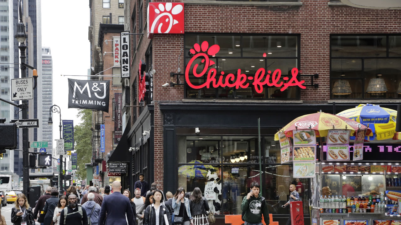 People walk past a new Chick-fil-A restaurant, Thursday, Oct. 1, 2015 in New York.