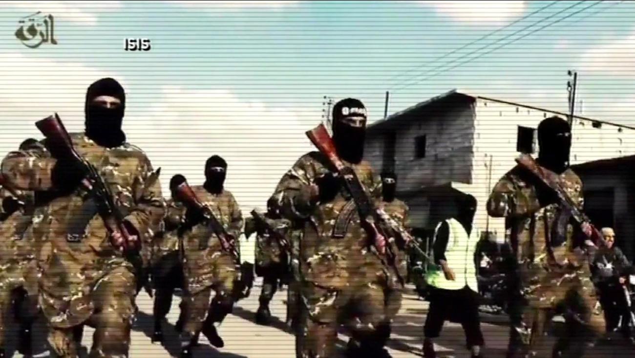 FILE -- ISIS troops.