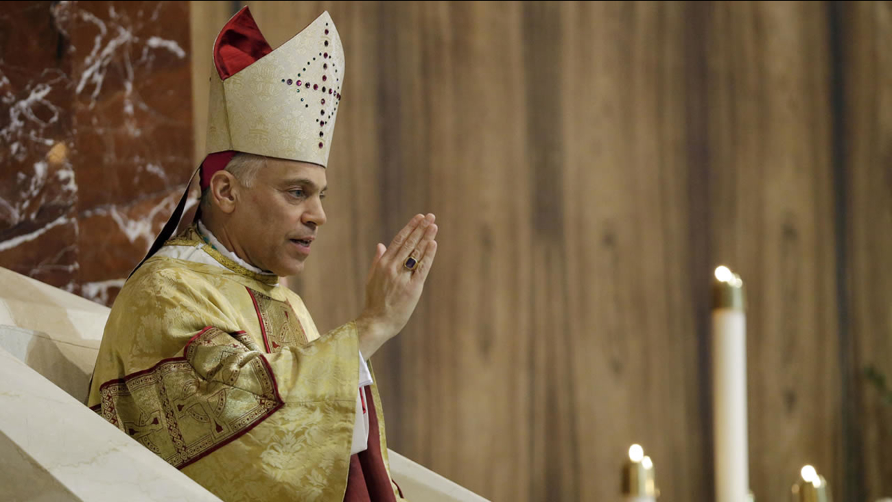 Salvatore J. Cordileone gives a blessing during a ceremony to install him as the new archbishop of San Francisco, Oct. 4, 2012. (AP Photo/Marcio Jose Sanchez, Pool)