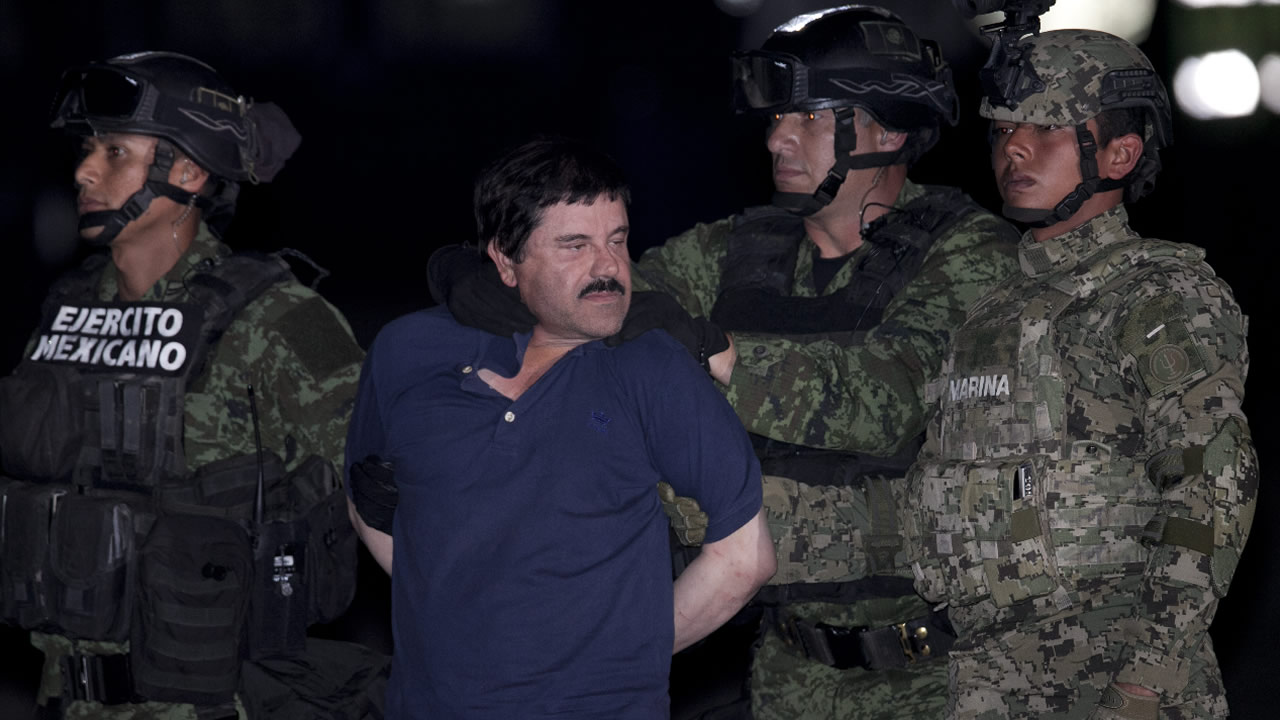 """Joaquin """"El Chapo"""" Guzman is made to face the press as he is escorted to a helicopter in handcuffs by Mexican soldiers and marines at a federal hangar in Mexico City, Mexico, Friday, Jan. 8, 2016."""