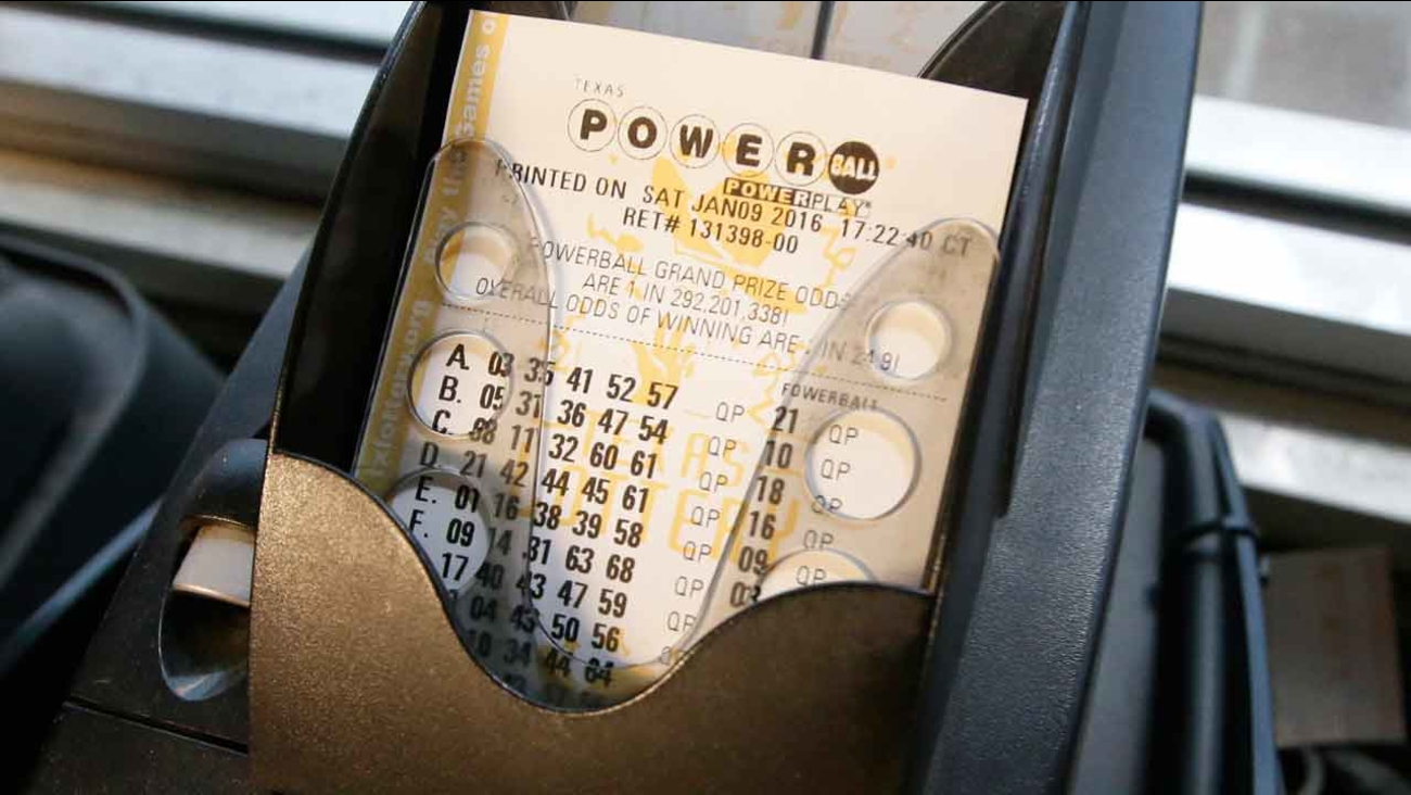 A Powerball lottery ticket is printed in Dallas, Saturday, Jan. 9, 2016.