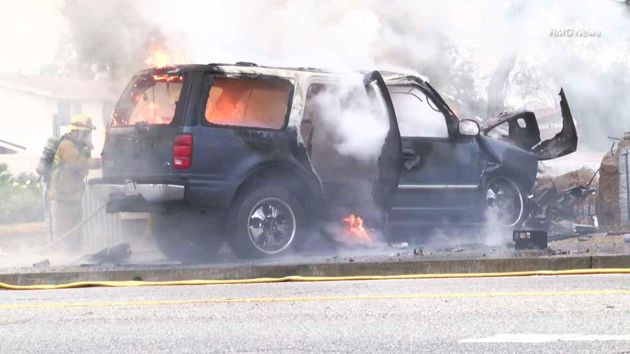 A car erupted in flames following a crash in Tarzana on Saturday, Jan. 9, 2016, where a Good Samaritan saved four passengers.