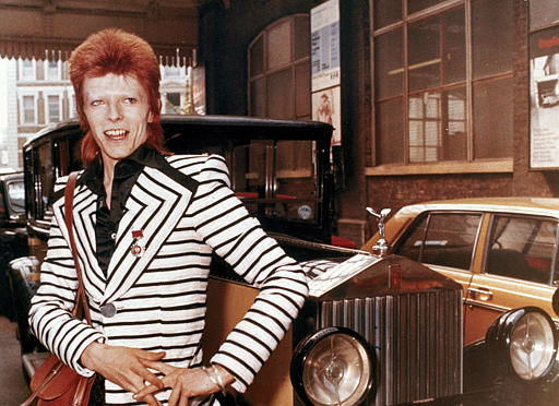 "<div class=""meta image-caption""><div class=""origin-logo origin-image none""><span>none</span></div><span class=""caption-text"">British rock singer, David Bowie, poses beside his Rolls Royce in May 1973. (AP Photo) (AP Photo/ XCJ AD)</span></div>"