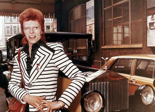 "<div class=""meta image-caption""><div class=""origin-logo origin-image none""><span>none</span></div><span class=""caption-text"">British rock singer, David Bowie, poses beside his Rolls Royce in May 1973. (AP Photo) (AP Photo/ XCJ AD)</span></div>"