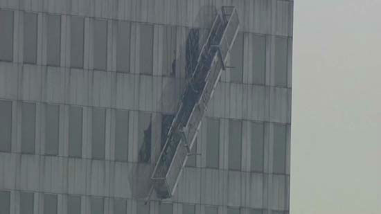 """<div class=""""meta image-caption""""><div class=""""origin-logo origin-image none""""><span>none</span></div><span class=""""caption-text"""">Two workers were rescued from outside a 75-story building in downtown Houston (KTRK Photo)</span></div>"""