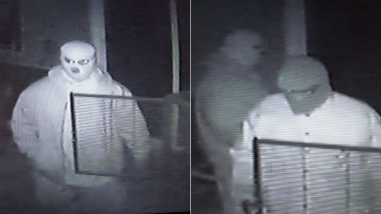 Two residential burglary suspects are seen in surveillance still images released by the San Bernardino Sheriff's Department and the Victorville Police Department.