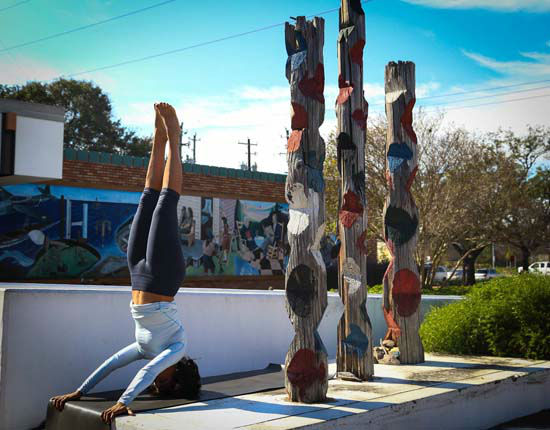 """<div class=""""meta image-caption""""><div class=""""origin-logo origin-image none""""><span>none</span></div><span class=""""caption-text"""">This is what I do to unwind, stand on my head. The twist here is doing it with straight arms. I never even attempted a headstand like this until I was about 46."""" Pose: Headstand (Gina Gaston/Layla Salek)</span></div>"""