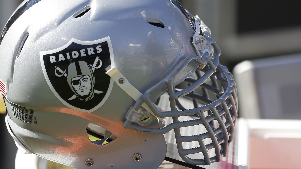 The helmet of Oakland Raiders' Justin Tuck is shown during the second half of an NFL football game against the Denver Broncos in Oakland, Calif. on Oct. 11, 2015. (AP Photo)