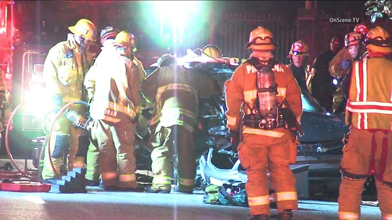 Emergency personnel respond to a fatal crash near the intersection of N. El Molino Avenue and E. Maple Street in Pasadena on Tuesday, Jan. 12, 2016.