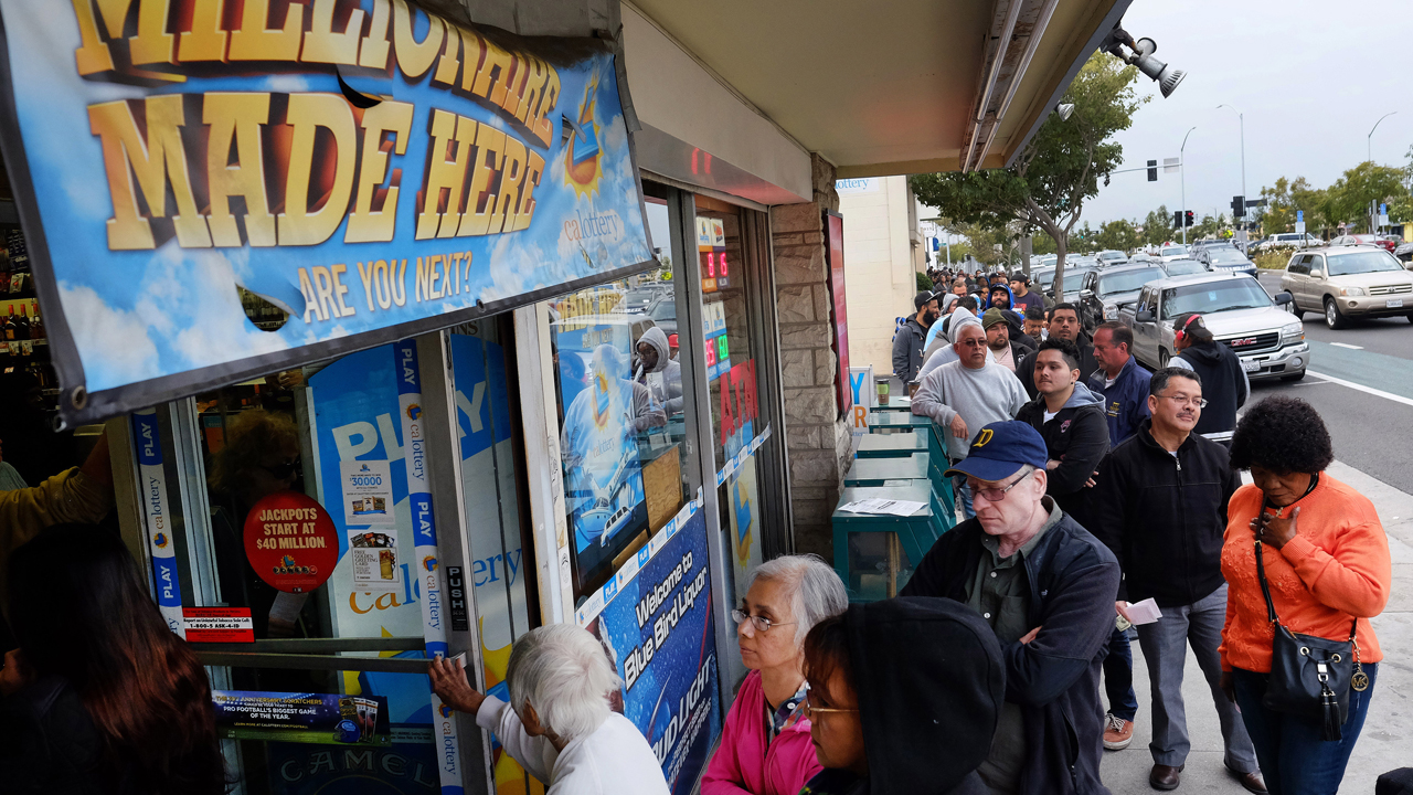 Customers wait in line at the Blue Bird Liquor Store to buy Powerball lottery tickets in Hawthorne, Calif. on Saturday, Jan. 9, 2016.