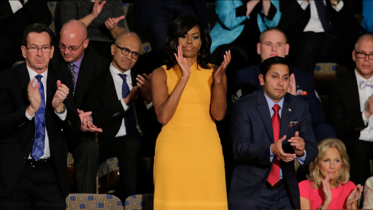 First lady Michelle Obama in a yellow dress