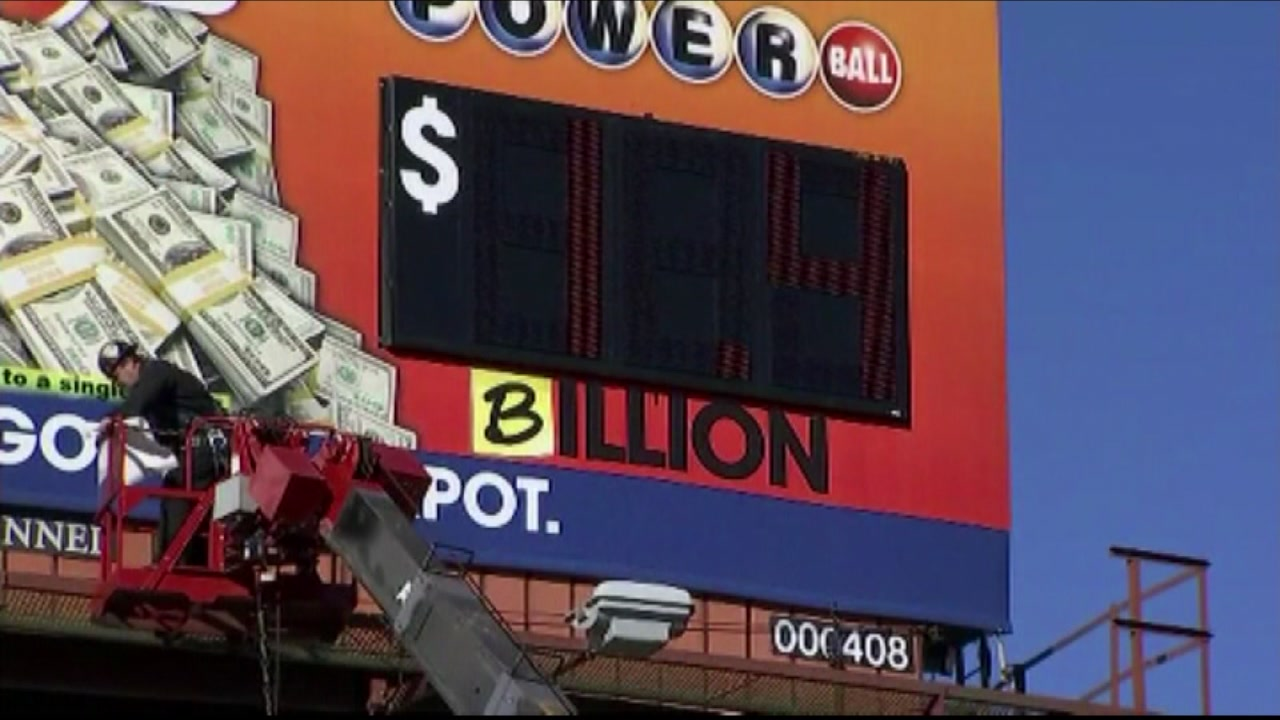 Lottery officials in Atlanta changed a sign to reflect that the Powerball jackpot is a billion on Tuesday, January 12, 2016.