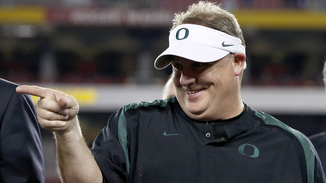 In this Jan. 3, 2013 file photo, Oregon head coach Chip Kelly celebrates with his players after the Fiesta Bowl NCAA college football game against Kansas State, in Glendale, Ariz. (AP Photo/Ross D. Franklin, FIle)