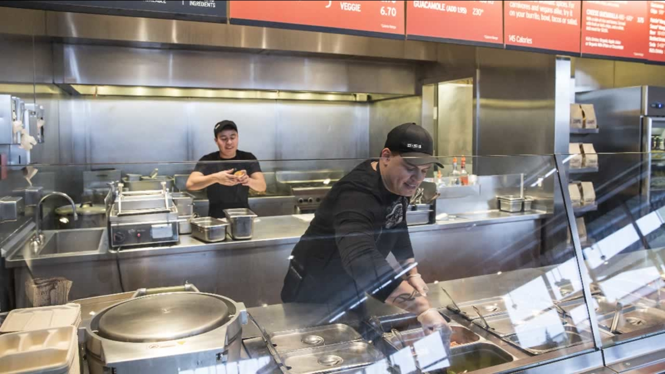 A Chipotle Mexican Grill employee prepares food on Tuesday Dec. 15, 2015, in Seattle.
