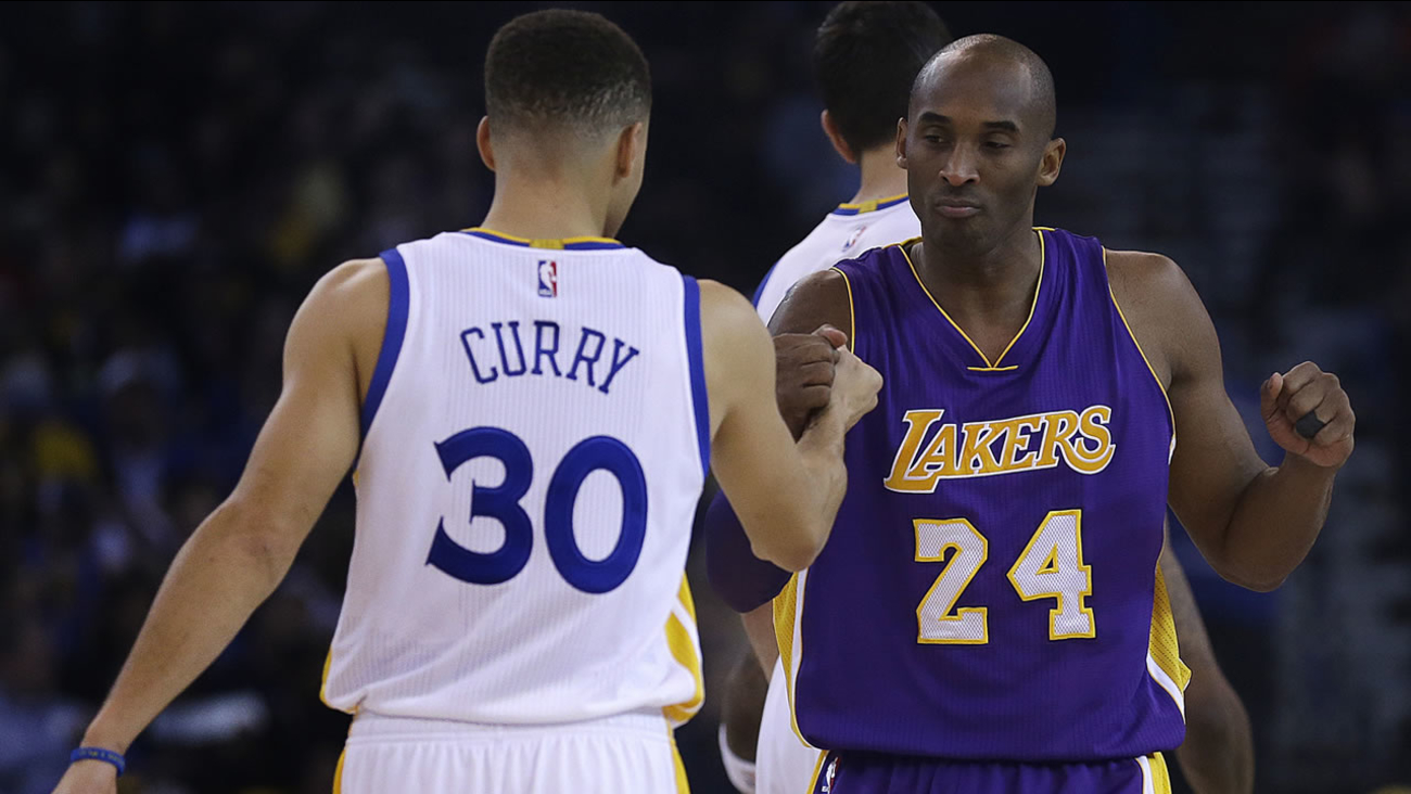 Los Angeles Lakers' Kobe Bryant, right, greets Golden State Warriors' Stephen Curry (30) prior to an NBA basketball game Thursday, Jan. 14, 2016, in Oakland, Calif. (AP Photo/Ben Margot)