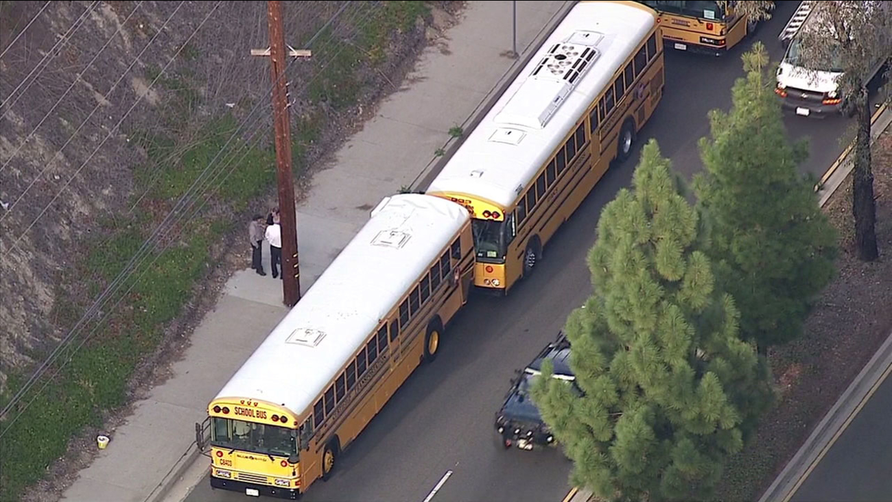 Officials said one adult was taken to the hospital and 14 children were treated at the scene of a crash involving two school buses in Rolling Hills Estates on Jan. 15, 2016.