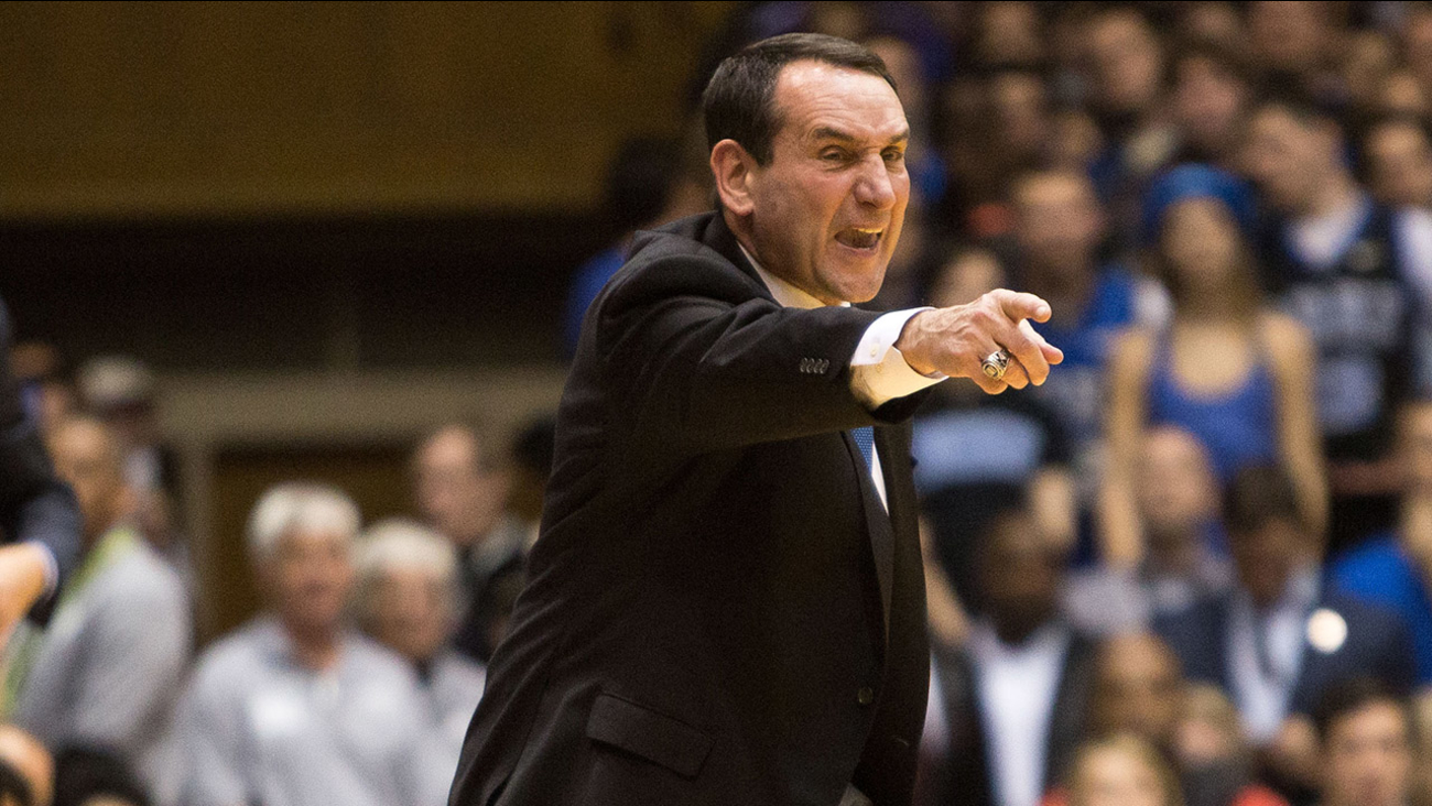 Duke head basketball coach Mike Krzyzewski shouts towards the court during the first half of an NCAA college basketball game against Notre Dame at Cameron Indoor Stadium in Durham