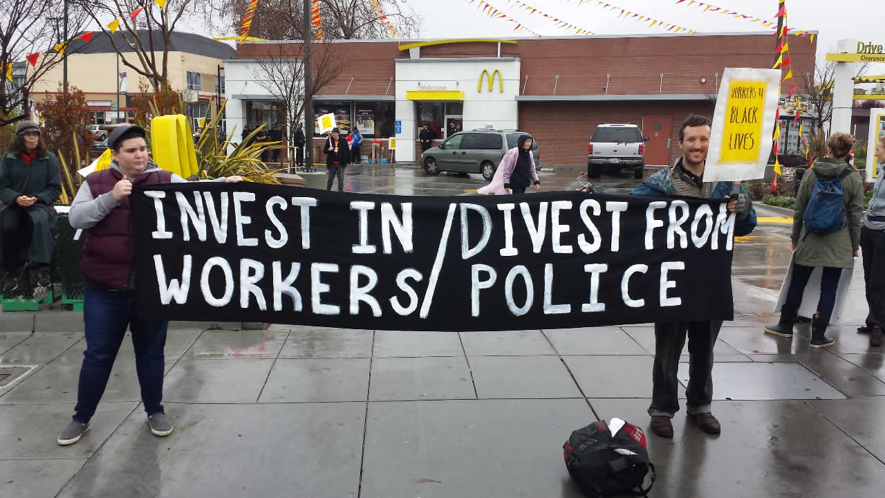 Activists demonstrate outside a McDonald's in Oakland, Calif., on Saturday, January 16, 2016.