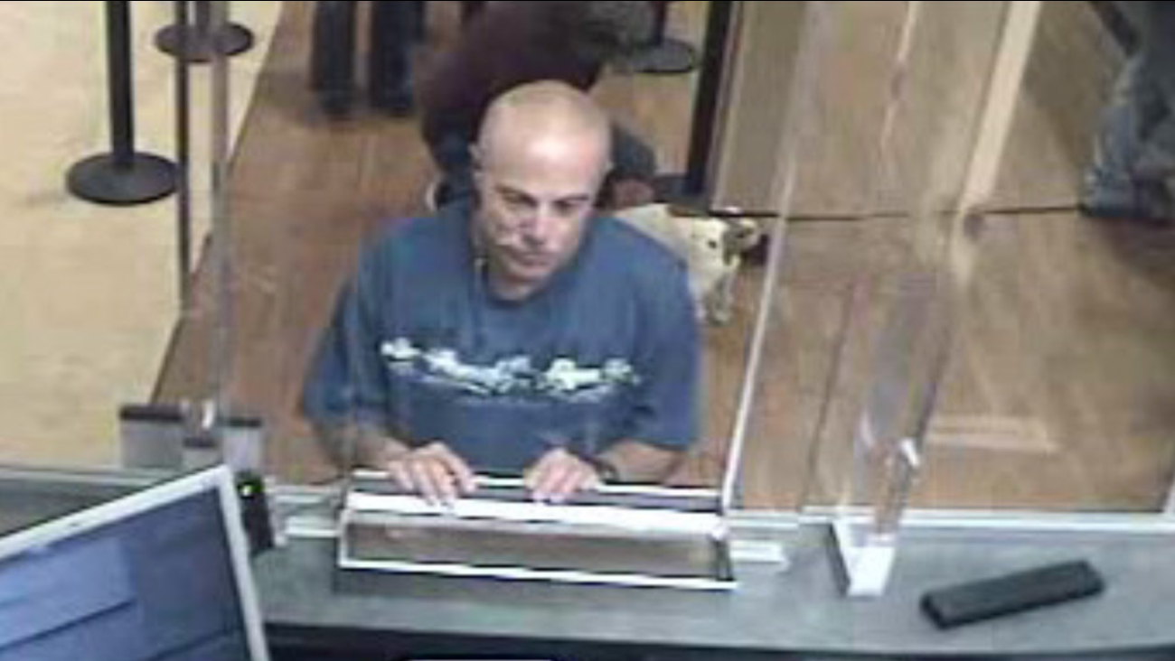 A bank robbery suspect is shown in surveillance video from a Ventura Chase Bank branch on Friday, Jan. 15, 2016.