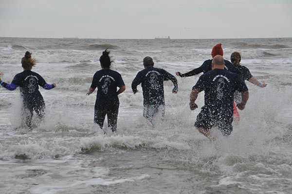 "<div class=""meta image-caption""><div class=""origin-logo origin-image none""><span>none</span></div><span class=""caption-text"">Supporters, friends and family took the Polar Plunge to benefit Special Olympics Texas at Galveston's Stewart Beach on Saturday, January 16, 2016. (KTRK Photo/ Gina Larson)</span></div>"